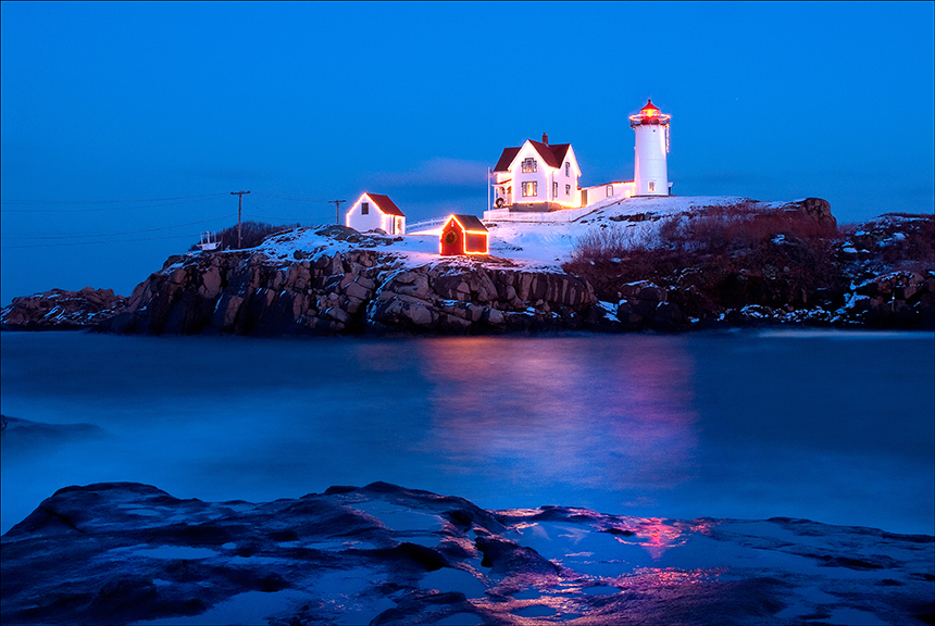 nubble cape neddick lighthouse lit up for the holiday season