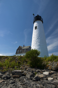 Wood Island lighthouse guides mariner's away from its rocky shores.