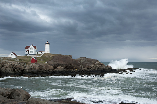 Storm clouds over Nubble lighthouse a few miles from the New Hampshire border.