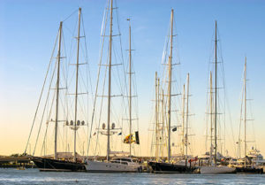 Tall sailing vessels are docked in Newport's harbor.