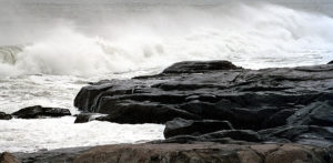 Cold waves crashing on rocks
