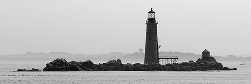 Graves lighthouse as fog lifts from Boston Harbor