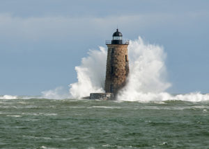 Giant waves cover the stone tower of Whaleback lighthouse in southern Maine during an astronomically high tide.