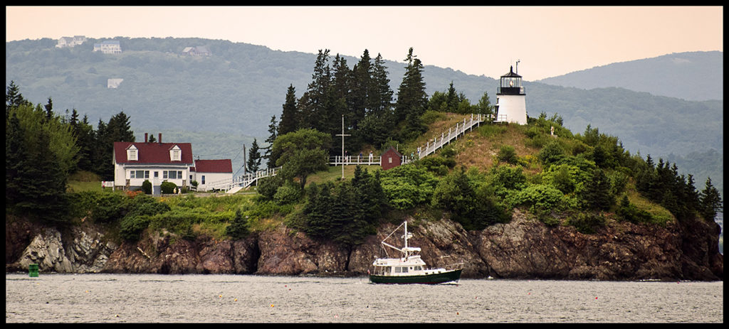 Owls Head Lighthouse Overlooks Rockland Harbor From 100 Foot Cliffs