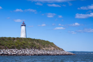 Faulkner's Island Lighthouse by Rocky Shore