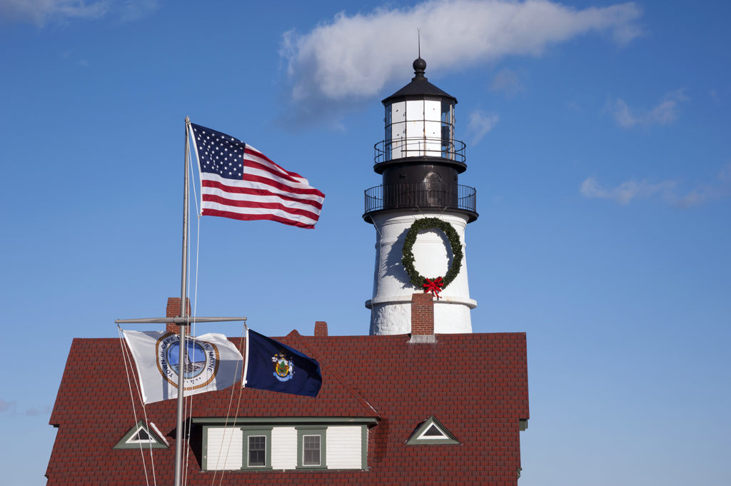 Flags Waving at Portland Head Lighthouse During Holiday Season