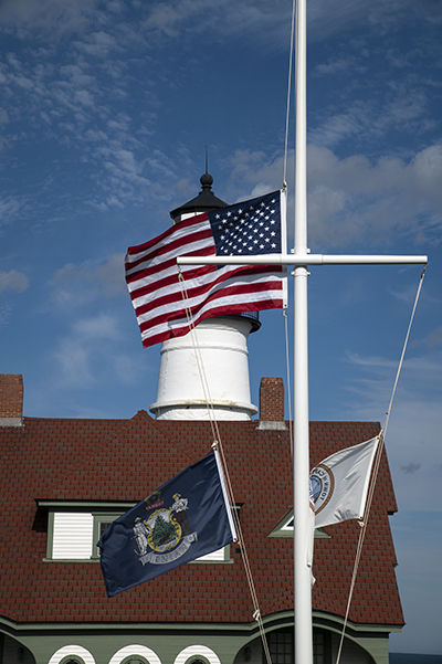 Flag at half mast on 9-11 at Portland Head Lighthouse in Maine